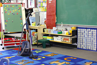 image of classroom rug with vacuum cleaner